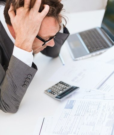 accountant frustrated over bookkeeping mistakes