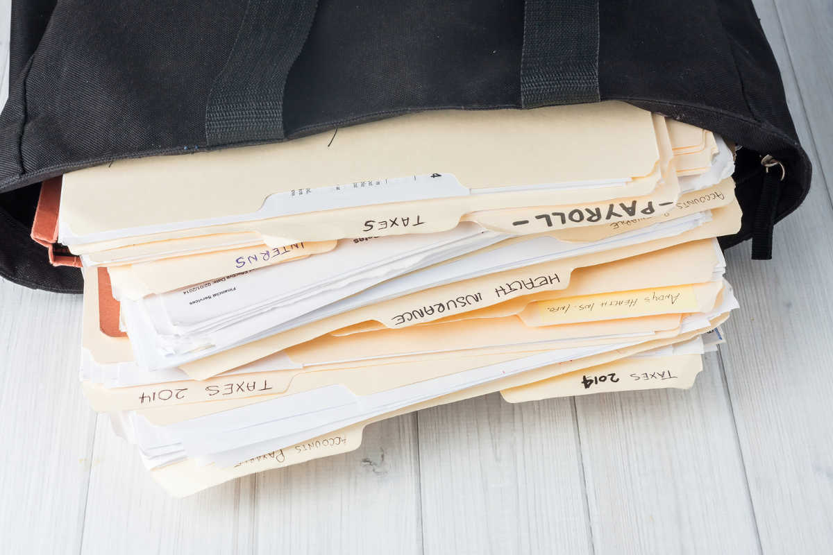 bag filled with bookkeeper's files
